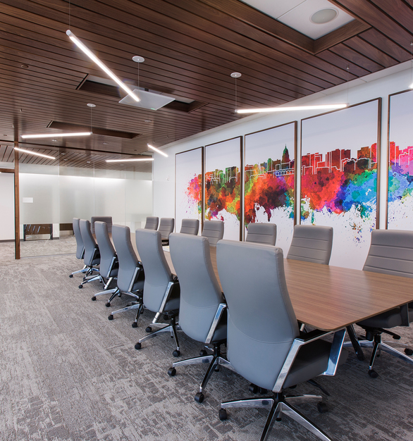 Frameless glass walls and wall graphics create a unique conference room atmosphere. OCL also provided their Dash™ Pendants to bring the different design elements together.