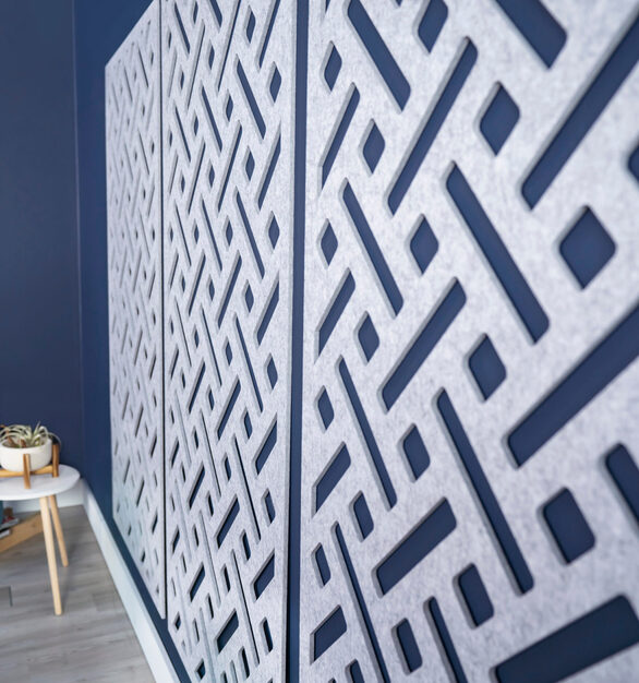 A closeup view of the mounted wall panels shows the detail and texture of the acoustic panel.