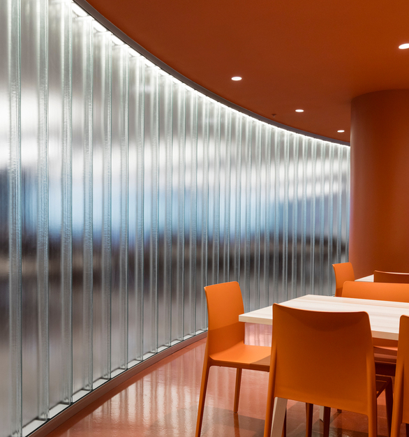 Bendheim's channel glass is a superior alternative to opaque walls, prioritizing aesthetics and daylight benefits, while offering visual and acoustic privacy. Photo by Maxime Brouillet.