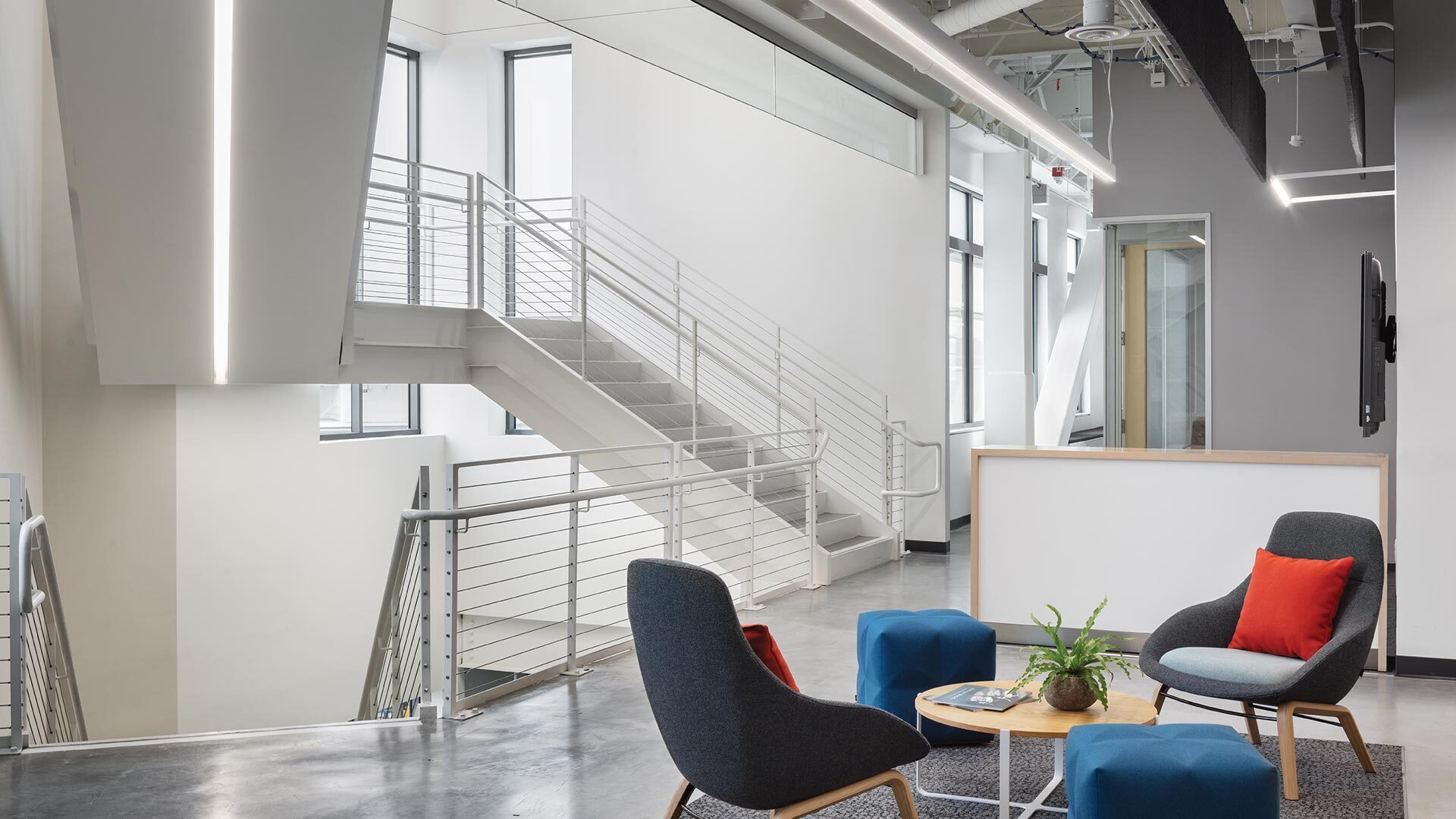 SFO Consolidated Administration Campus is located in San Fransisco, CA featuring lighting products by Acuity Brands - A-Light. Project in collaboration with JS Nolan, Mark Cavagnero Associates Architects, Perkins + Will, Webcor Builders, and Acuity Brands agent 6500.   Photographer: Mike Kelley