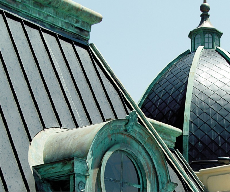 Custom Dormers, standing seam roofing panels, flashing, finials and domes embellish the ornate project.