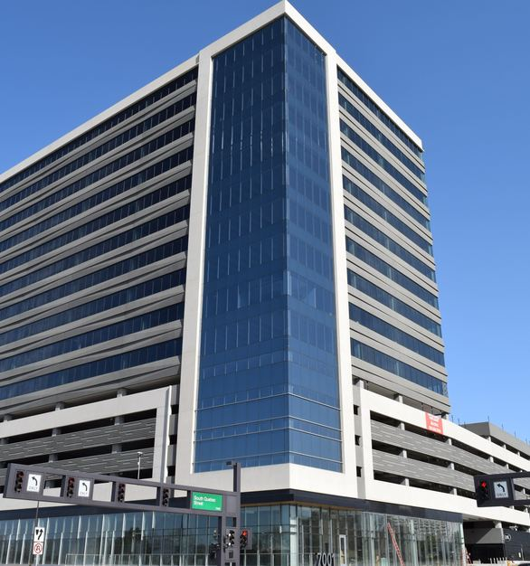 High-contrast colored panels on the 16-story office building in south Denver mimic the fast-moving light-rail trains and the cars on nearby Interstate 25. The building's main corner includes a patio and a pavilion that invite in passers-by from the neighborhood.