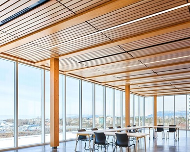 The open meeting room is a great space to host a variety of meetings with it's floor to ceiling windows and specialty wood ceiling with lighting from Fluxwerx.