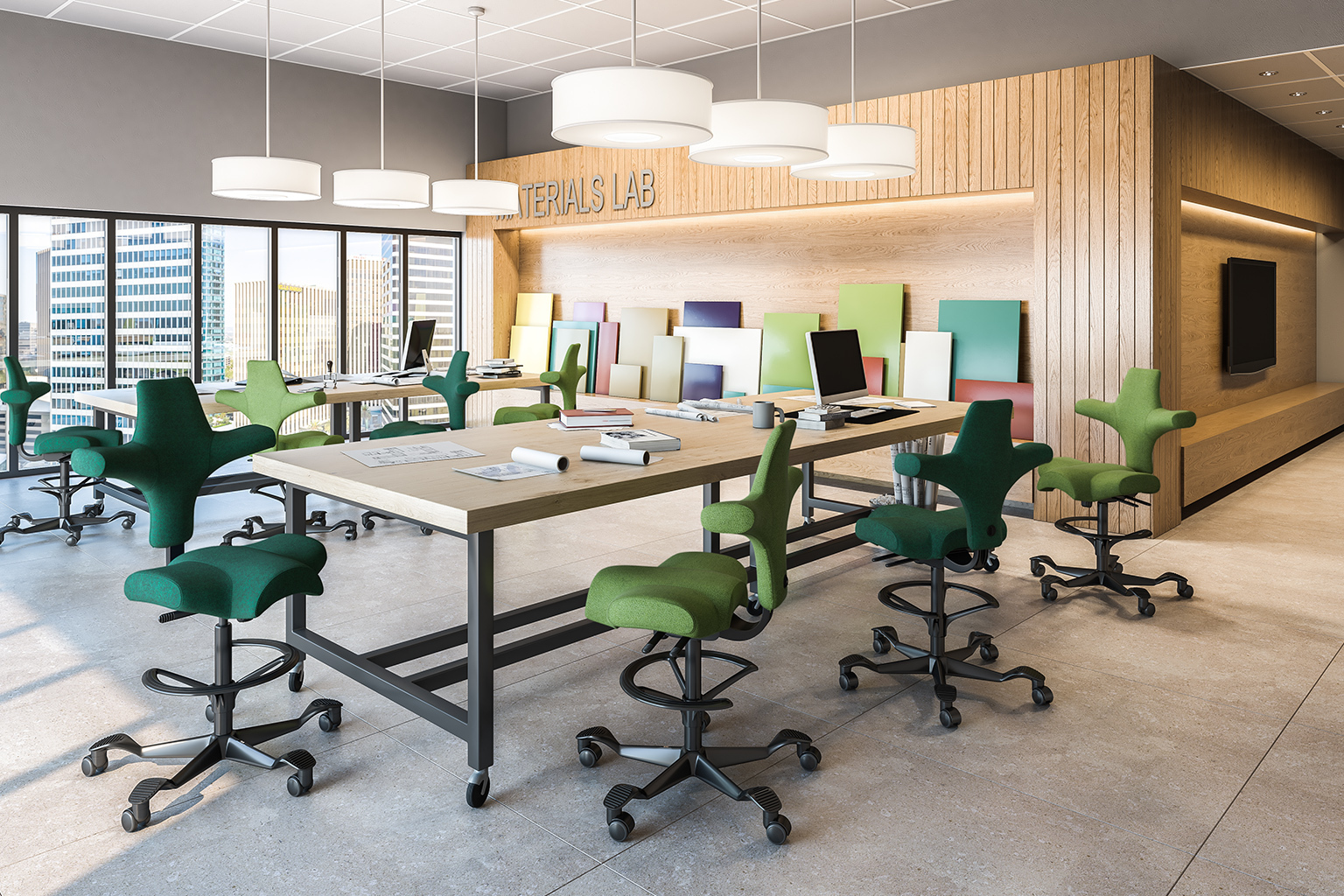 The HÅG Capisco chair has altered the way people find comfort while performing work. See here in an open office environment.