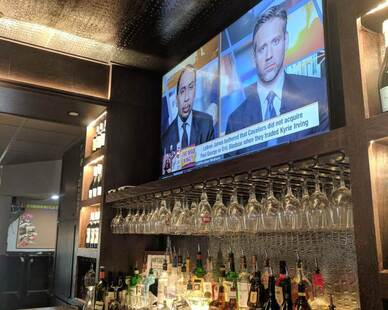 The restaurant bar design has ASI custom panels in the back behind the glasses and bar to create an accent background.