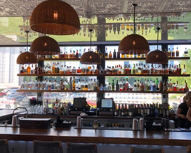 Mediterranean-style tin ceiling tiles are perfect for this outdoor bar.