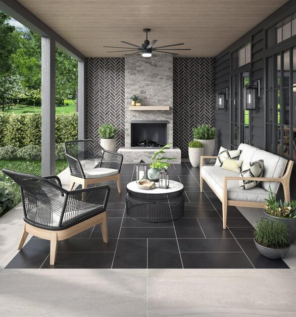 This outdoor lounge space is complete with modern furniture and a fireplace. The use of tiles for the floor and wall offer style and function for the area.