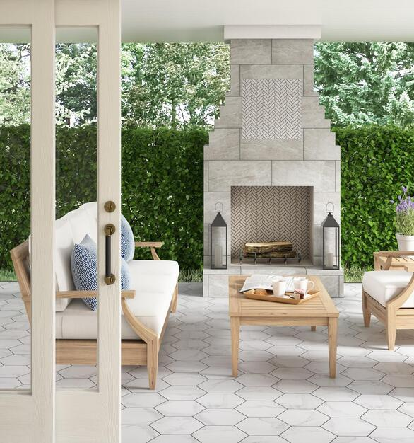 This outdoor lounge space features an array of tiles from Floor & Decor. Different shapes, textures and colors help complete this soothing space.