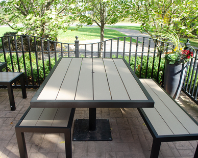 Savor this outdoor patio with this table and bench seating.  Perfect for those grill outs with your family and friends.  The table and bench for the courtyard furniture is made out of recycled plastic lumber.