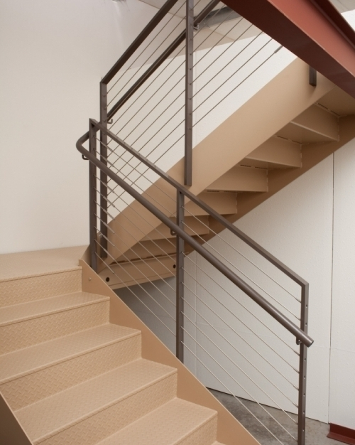 The stairs and landings can be galvanized or primed in anticipation of the on-site application of a final finish coat of paint. The 200 Series Checker Plate Stair System requires no further work after installation.