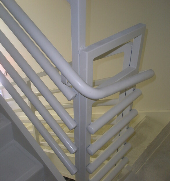 Pacific Stair Corporation's 200 series pipe rail is an economical, tube steel frame, which has an equally spaced inline pipe and is an industry standard rail design.
