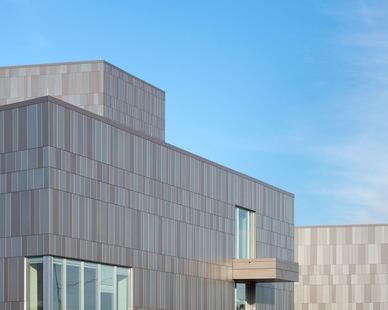 Multiple tones of grey create a beautiful exterior of painted aluminum panels by Dri-Design