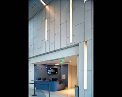 The vertical panels have spaces of recessed lighting to create a beautiful lobby entrance at Mississippi Arts.