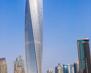 Cayan Tower is the world's tallest true twisting building.  Located along the Dubai Marina, the luxury residential tower is an iconic symbol to the marina's skyline clearly along the gulf. Images © SOM