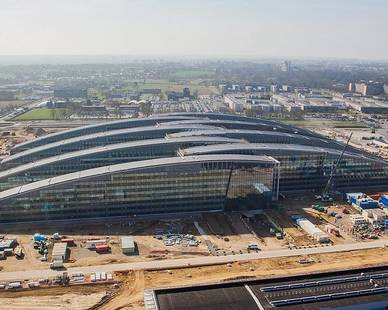 As one of Europe's largest and most environmentally sensitive buildings, the NATO Headquarters complex utilizes sophisticated water retention and geothermal harnessing systems and a high-performance exterior wall system. Images © SOM