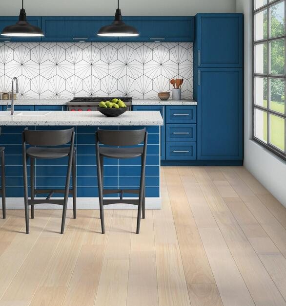 The light hues, pattern of the backsplash and wood flooring create an airy ambiance for the work breakroom area.