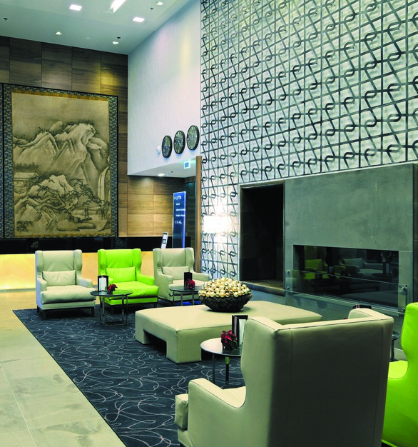 Give your clients something to look at while they are relaxing or waiting in your lounge.  This lounge has two different feature walls, one with a large mural and another patterned wall.