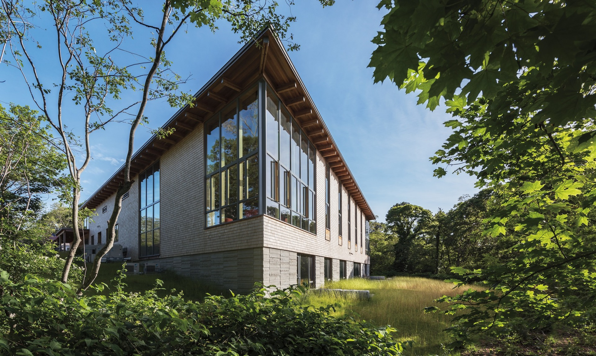 The library design incorporates with its outdoor surroundings by incorporating wood elements throughout the exterior design. Pella provided their Architect Series® Traditional windows.