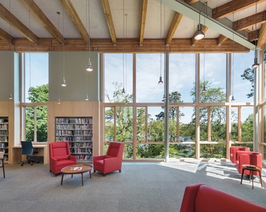 Natural light fills the open common area and workspace at Eastham Public Library featuring Architect Series® Traditional windows by Pella.