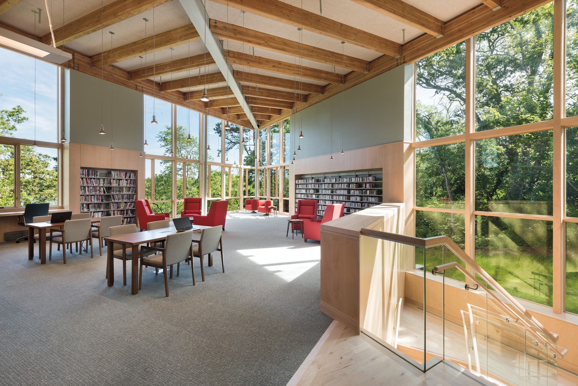 The naturally lit library common area promotes a healthy environment for guests to read, work, and gather. The Eastham Public Library features Architect Series® Traditional windows by Pella.