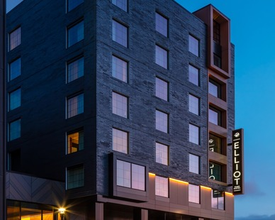 An evening shot of Elliot Park Hotel, showcasing the beautiful exterior brick finish and Pella® Impervia® windows.