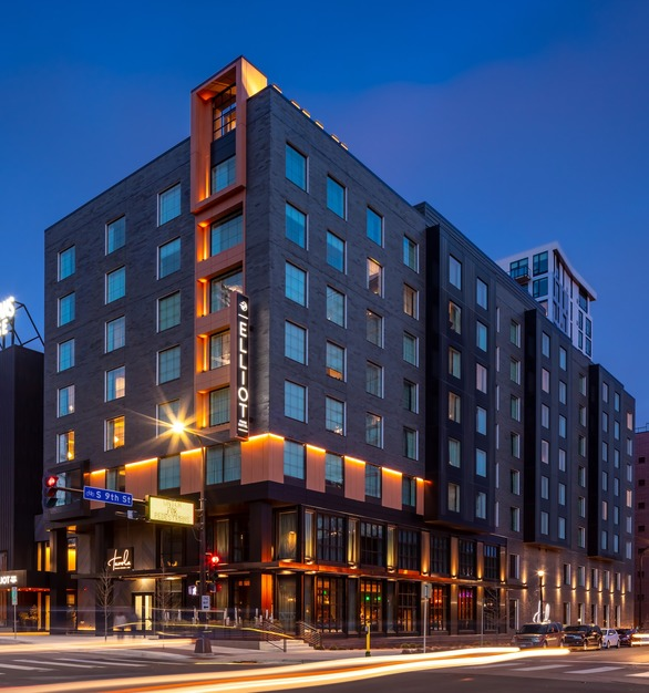 The striking exterior brick facade of Elliot Park Hotel featuring Pella® Impervia®windows for its durable construction and versatile design by Pella Windows and Doors.