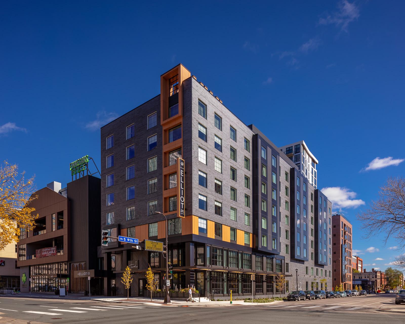 The dual-tone exterior finish of Elliot Park Hotel in Minneapolis, MN, featuring Pella® Impervia® windows by Pella Windows and Doors.
