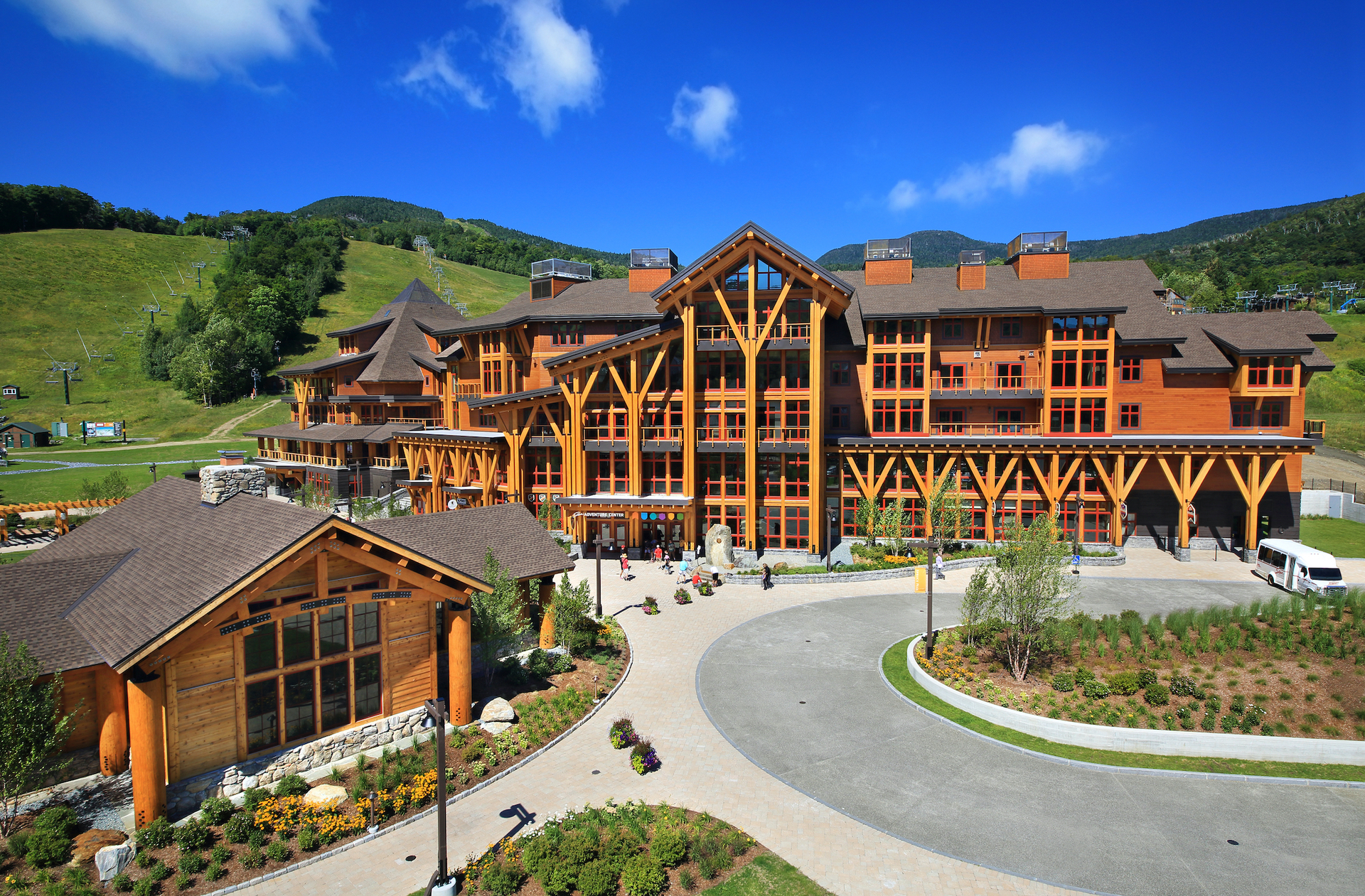 Pella's red aluminum-clad window systems blend with the design and finish of the wood exterior facade at Spruce Peak Village in Stowe, VT.