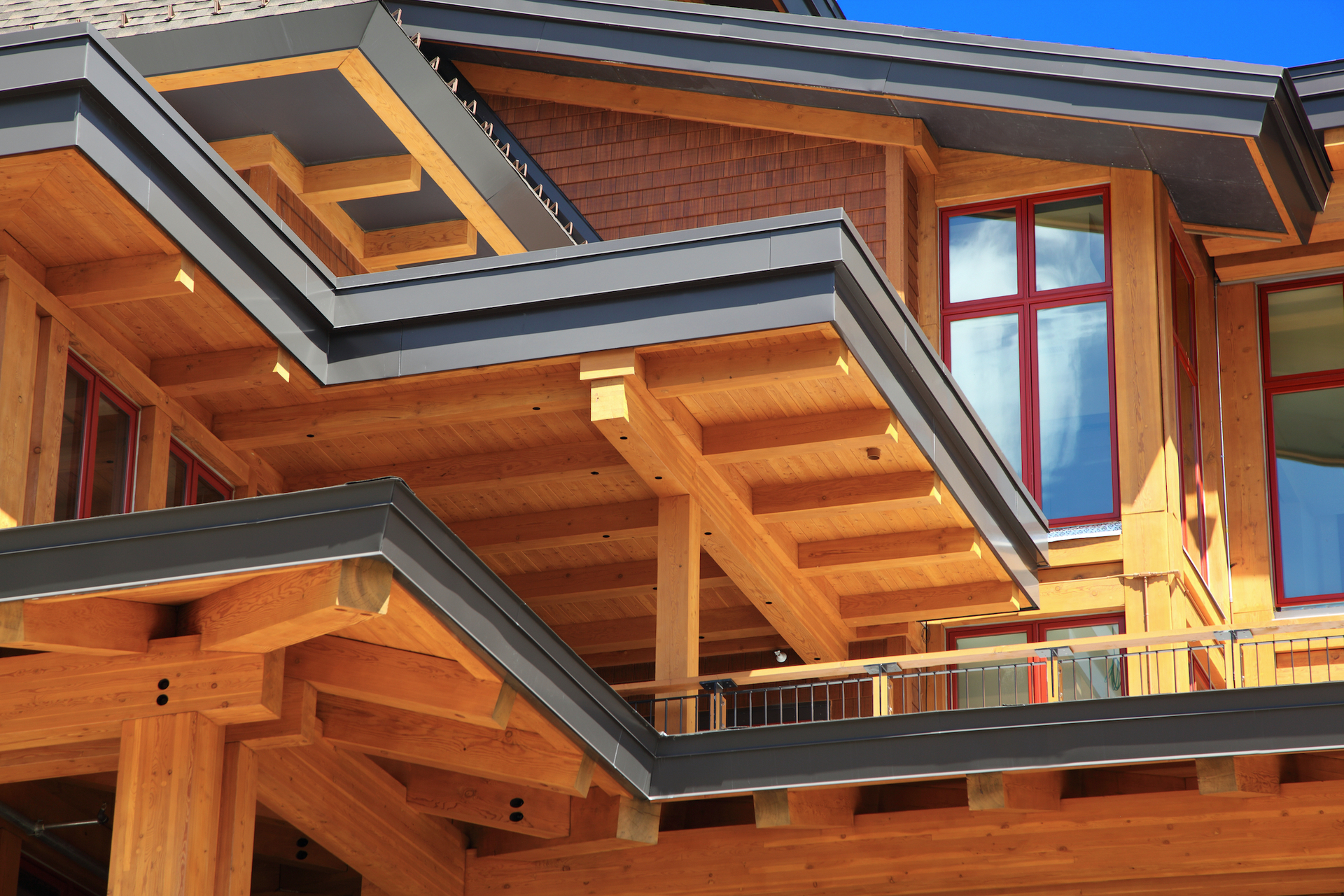 A closeup of the detailed wood exterior of Spruce Peak Village featuring aluminum-clad window systems by Pella.