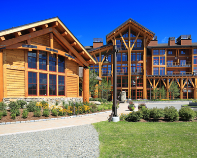 Pella provided red double-hung windows for the Spruce Peak resort project in Stowe, VT.