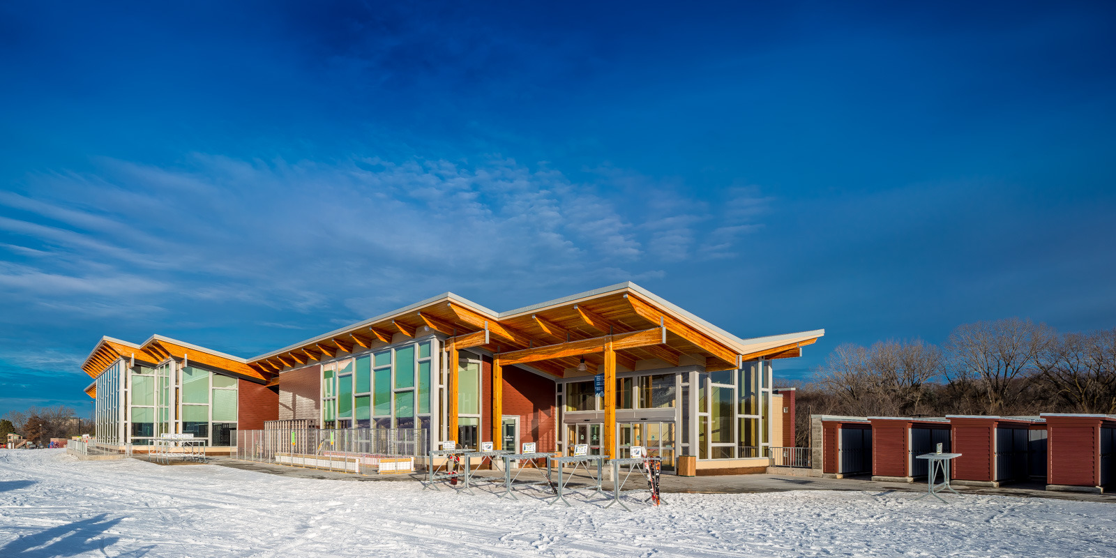 The exterior design of Hyland Ski Chalet featuring Pella® Support Products that complete the expansive exterior window facade that helped create a modern, energy-efficient building design.
