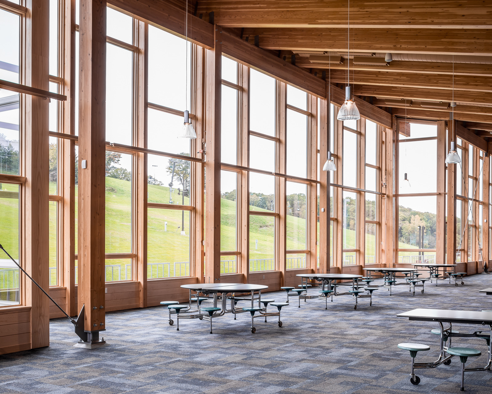 Natural light fills Hyland Ski Chalet's guest common area. Pella provided Pella® Support Products to create an impressive window wall where everyone could enjoy outdoor views while staying warm is colder weather.