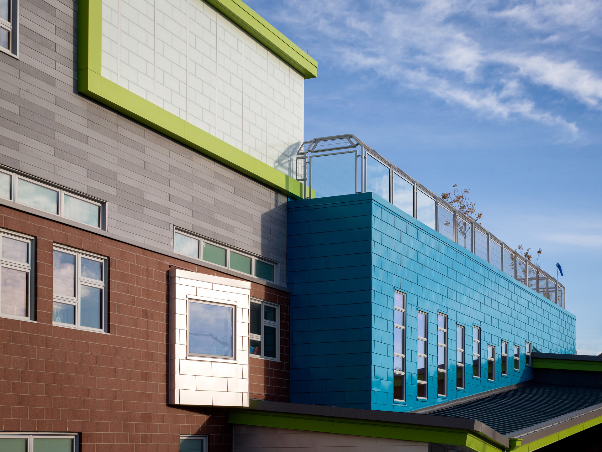 A multi-colored exterior encourages a vibrant and energetic atmosphere at Irwin M. Jacobson Elementary in New Bedford, MA. Architect Series® Traditional windows were used for the school's various window systems.