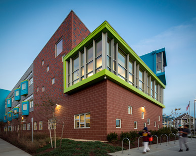 The striking brick and window facade at Irwin M. Jacobs Elementary School in New Bedford, MA. Pella provided their Architect Series® Traditional windows for their distinctive, fine-furniture detailing that adds drama and architectural interest to the building.