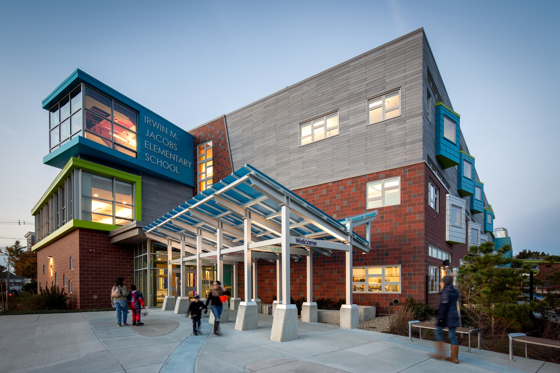 The vibrant and colorful main entrance at Irwin M. Jacobson Elementary in New Bedford, MA. Pella's Architect Series® Traditional windows were used for the various windows systems throughout the school.