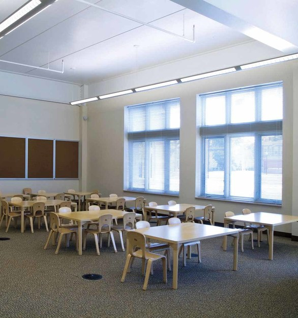 Pella windows contributed to the project's LEED-qualifying points for daylighting. The superior energy efficiency of the windows – along with sunshades that block direct sun while bouncing daylight deep into the rooms – allows for more glass area and more natural light to enter the classroom, reducing the need for artificial lighting.