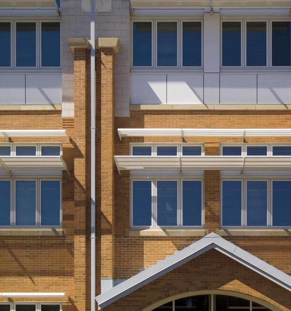 Innovative passive solar design elements like exterior sunshades, light shelves, and triple-glazing create valuable cost and energy savings for the school district.