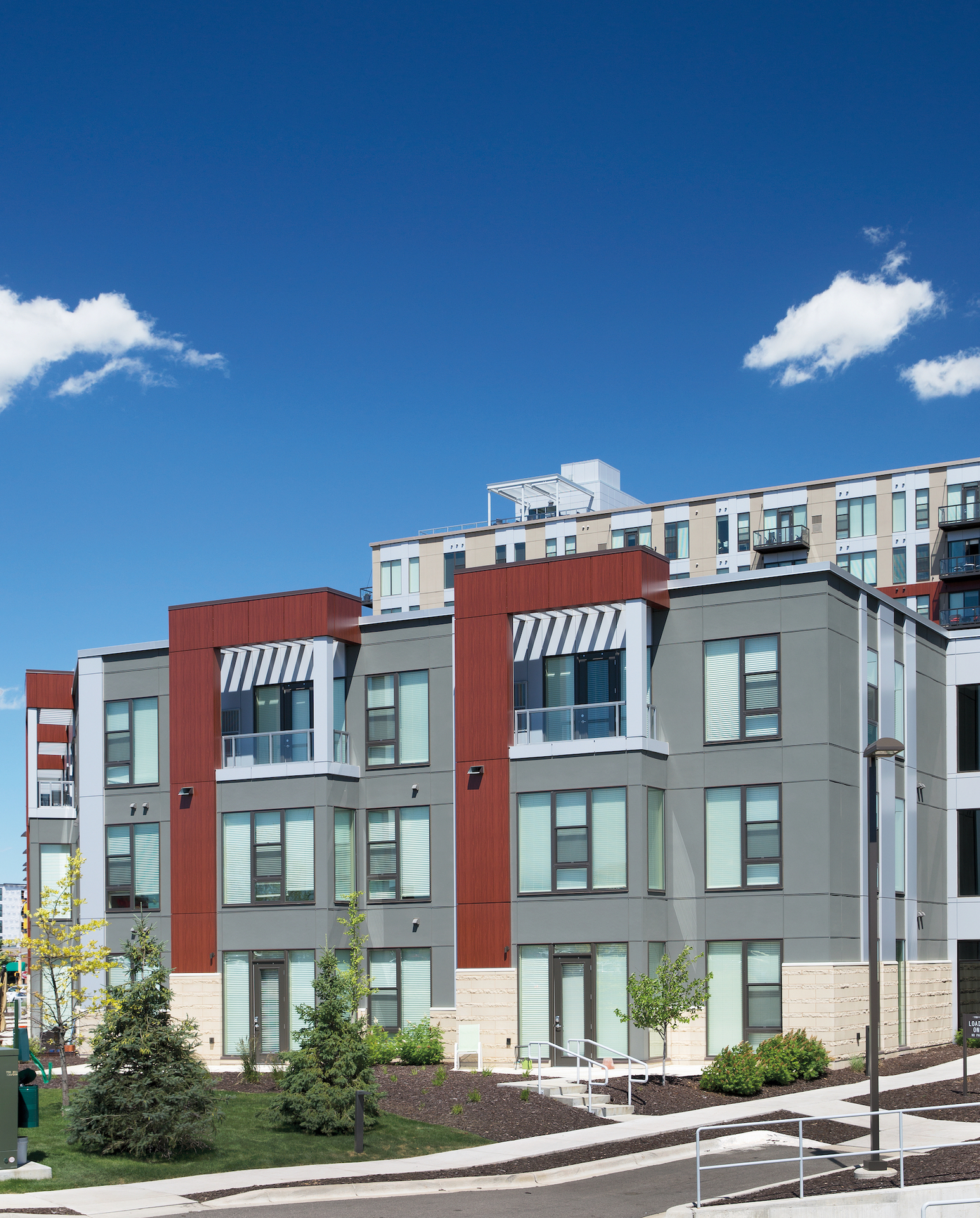 The apartment building complex compliments the design and look of the surrounding neighborhood. Modern exterior features, like the Pella® Impervia® windows and doors, add a modern aesthetic to the property.