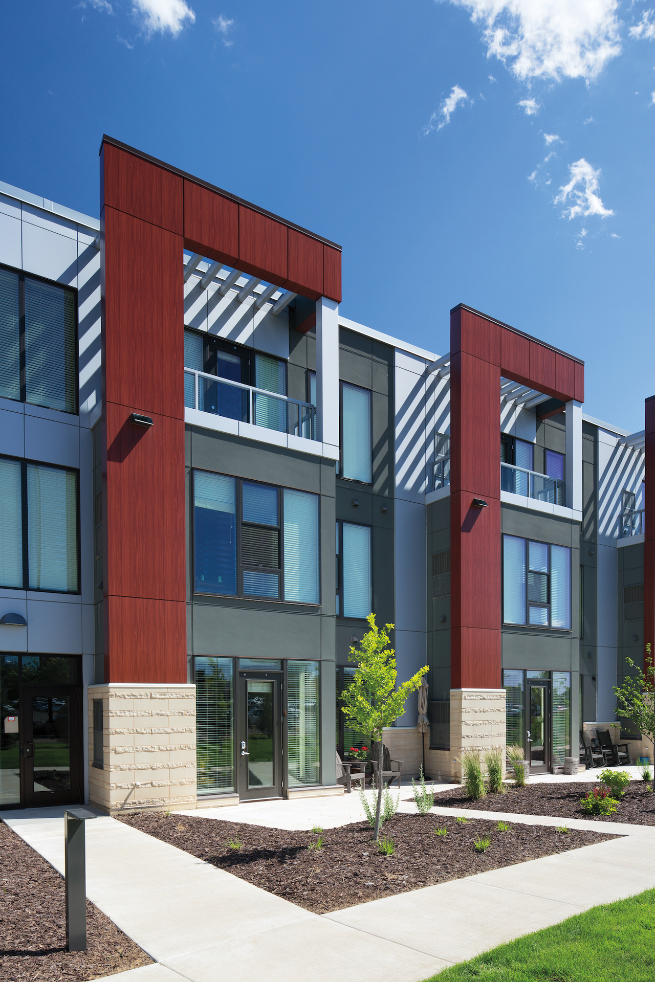 Pella® Impervia® windows and doors create a clean apartment building look at One Southdale Place in Edina, MN.