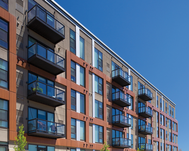Apartment building exterior and unit patio designs at One Southdale Place in Edina, MN. Pella was tasked with providing their Pella® Impervia® windows and patio doors for the project.