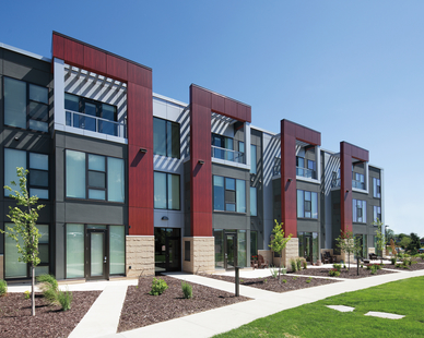 The vibrant landscaping and greenery accentuate the exterior colors of One Southdale Place in Edina, MN. Pella was asked to provide their Pella® Impervia® windows and doors for the project.