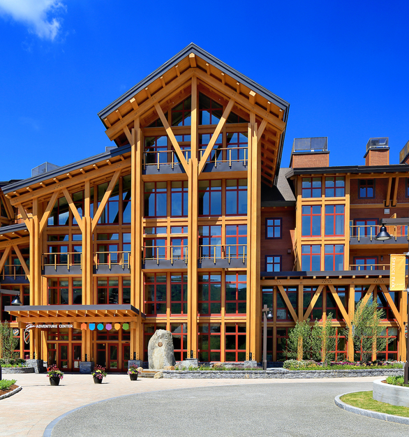 The front facade of The Spruce Adventure Center reflects the flexible multi-use space design inside the resort. Pella provided modern aluminum clad window systems to complete the eye-catching look.