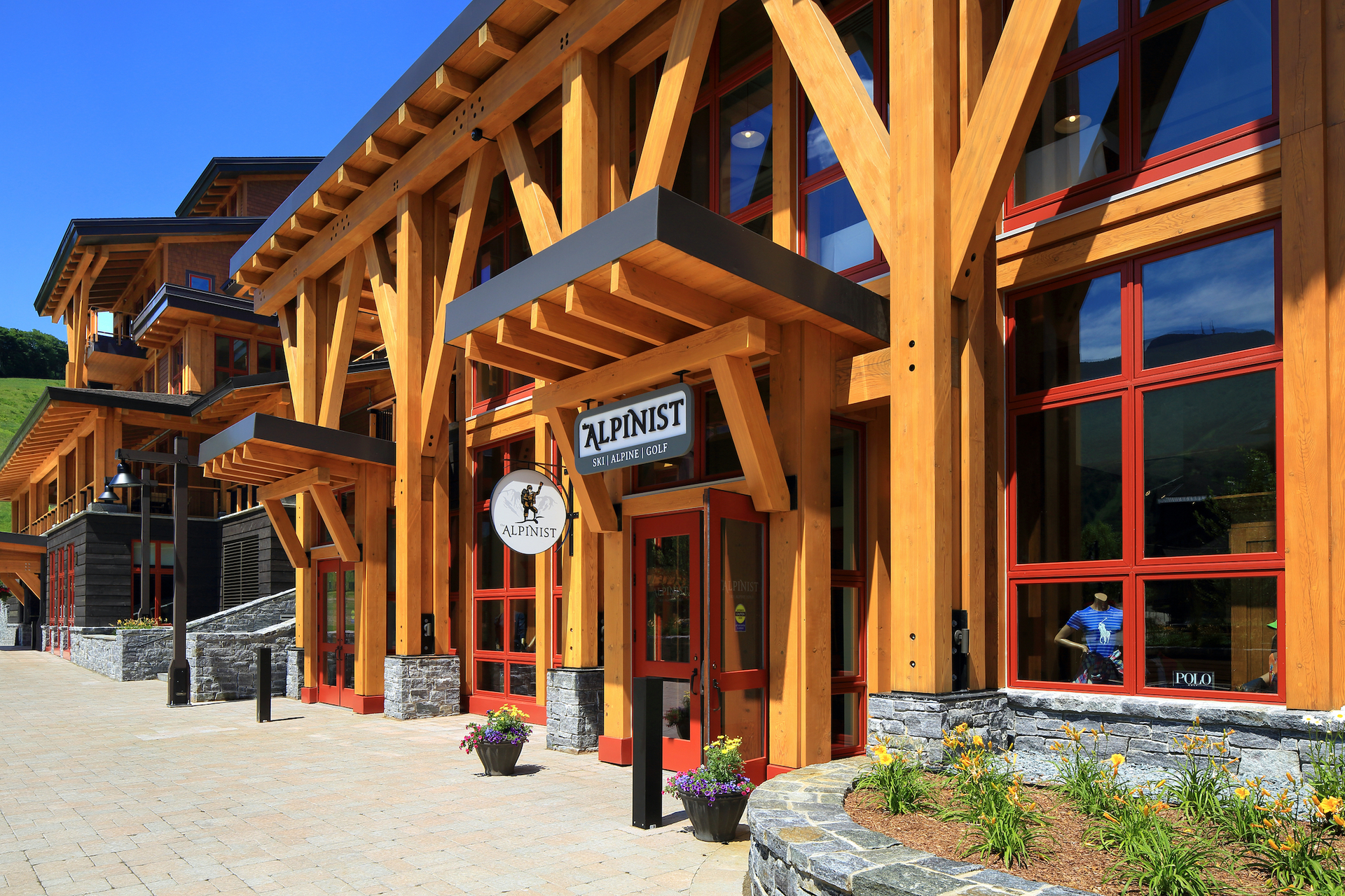 Pella provided aluminum-clad window systems for the Spruce Peak project to accomplish a unique color scheme that reflects the branding and style of the resort.