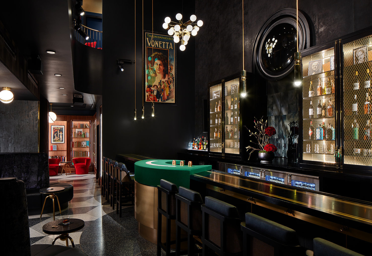 The performance bar of the Chicago Magic Lounge features luxurious seating and Art Deco interior design.