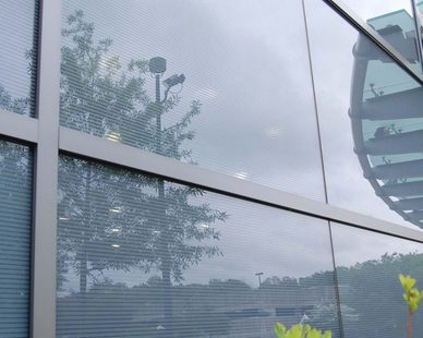 The St. Cloud Window 9000-A9 acoustic curtain wall expands the functionality of the existing building while creating a spirited identity of its own through its soft and flowing forms.