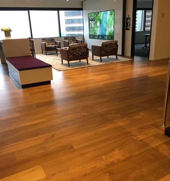 Reclaimed Teak wood flooring in an office lobby in Seattle, WA.