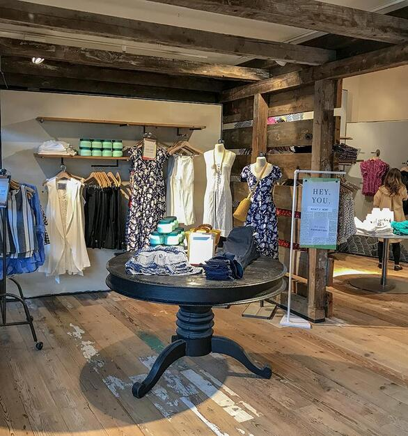 Pioneer Millwork reclaimed softwoods custom mix floor and reclaimed As-Found Industrial Timbers in Anthropologie, Natick, MA.