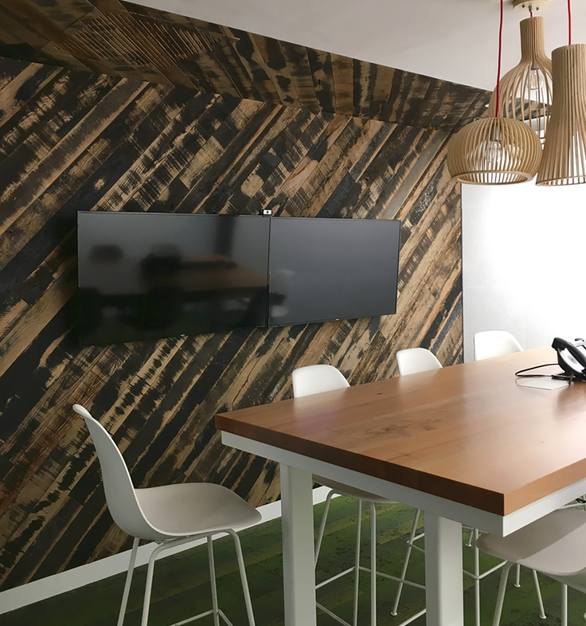 Pioneer Millworks reclaimed Oak Black and Tan 50/50 was used for wall paneling in this meeting room.