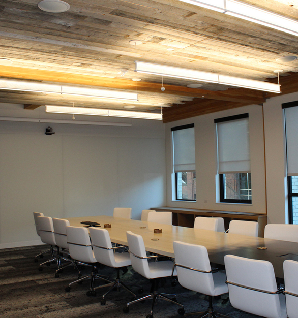 Pioneer Millworks Grandma's Attic reclaimed wood was used as ceiling accents in this office conference room in Portland, Oregon.