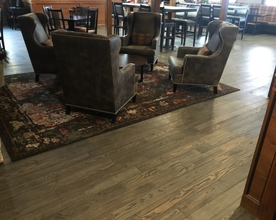 Pioneer Millworks provided unique flooring with rich character at Craftsman Inn and Suites in Syracuse, New York.
